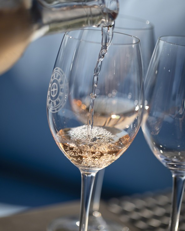 Pouring Rosé into glass